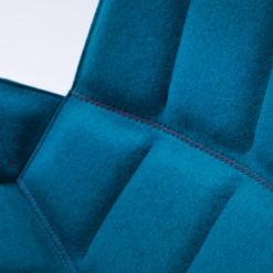 müller Martini Chair schwarz mit Filzauflage in türkis
